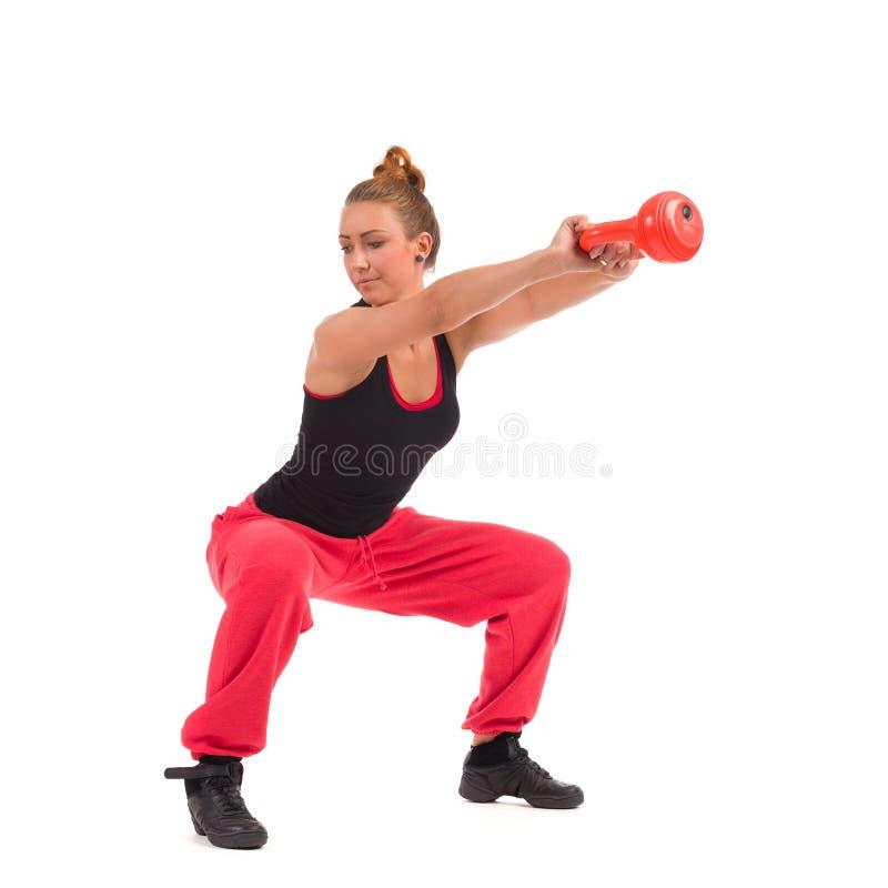 Vrouwelijke Geschiktheidsinstructeur Exercise met Kettlebell royalty-vrije stock afbeelding