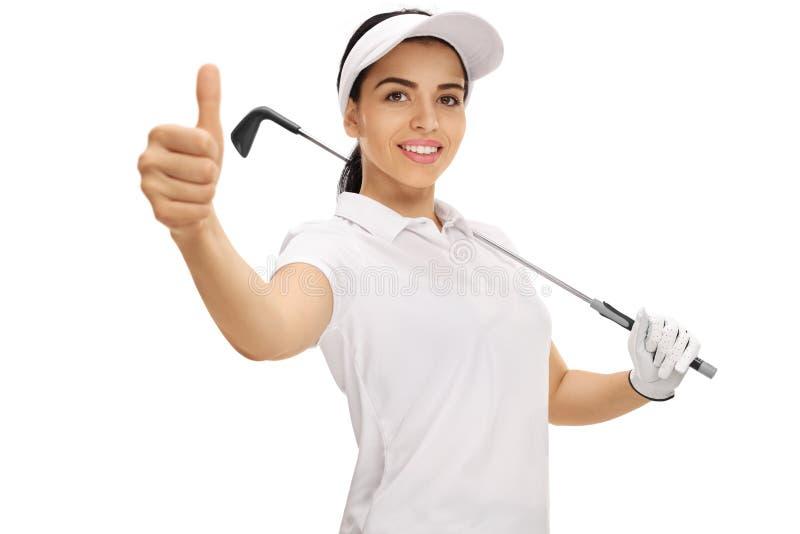 Vrouwelijke golfspeler die een duim op gebaar maken stock foto's