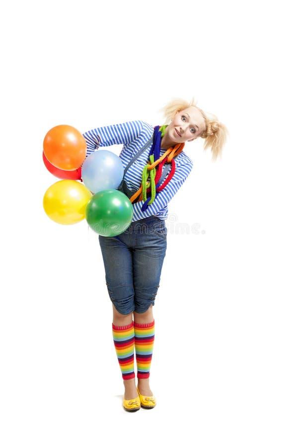 Vrouwelijke grappige clown met ballons royalty-vrije stock foto