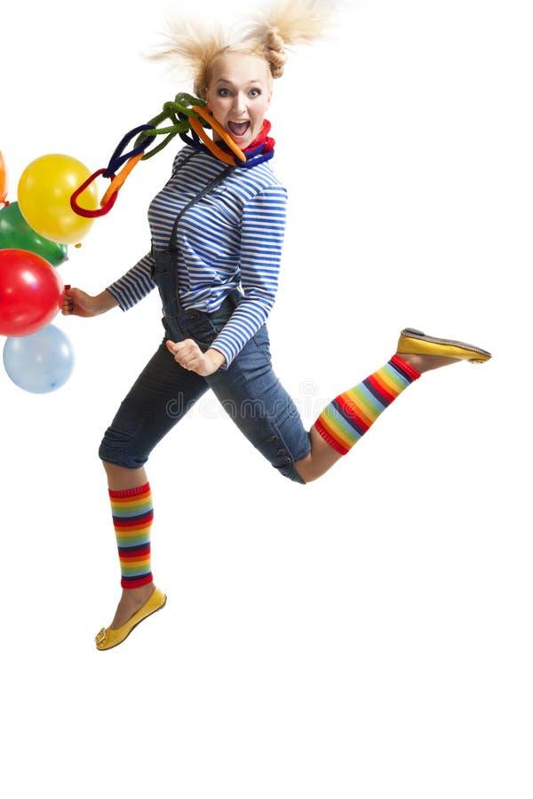 Vrouwelijke grappige clown met ballons royalty-vrije stock foto's