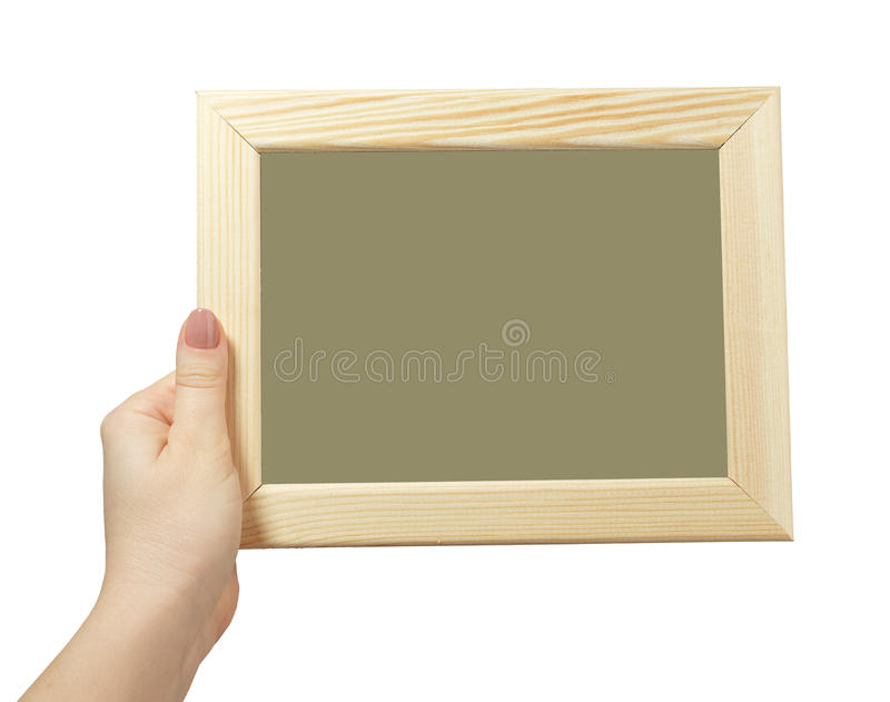 Vrouwelijke hand die een houten die kader houden op witte achtergrond wordt geïsoleerd stock foto's