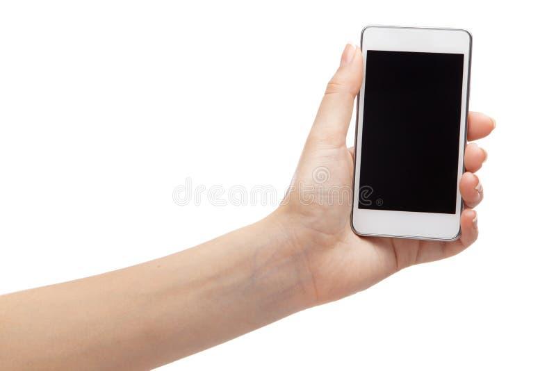Vrouwelijke hand die een moderne smartphone houden stock foto's