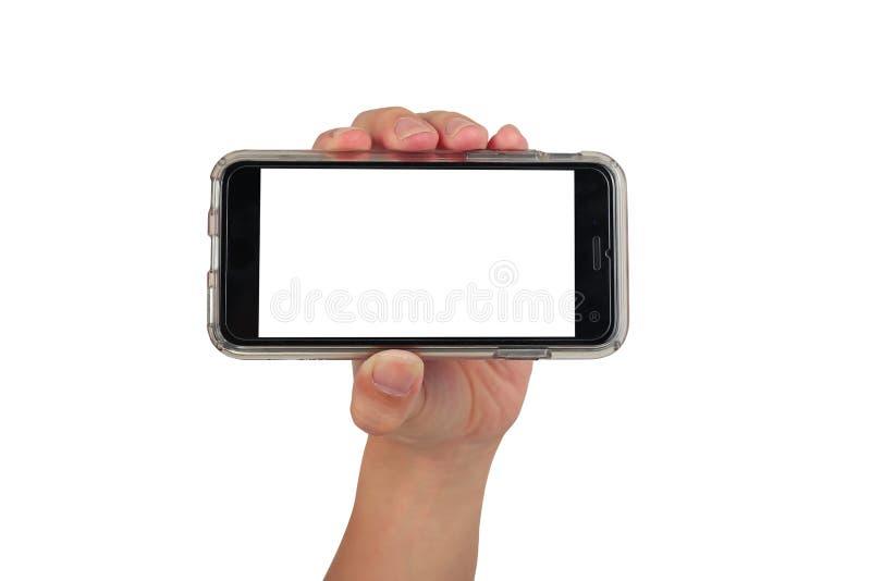 Vrouwelijke hand die horizontale slimme telefoon, gebruik het knippen weg houden stock afbeelding