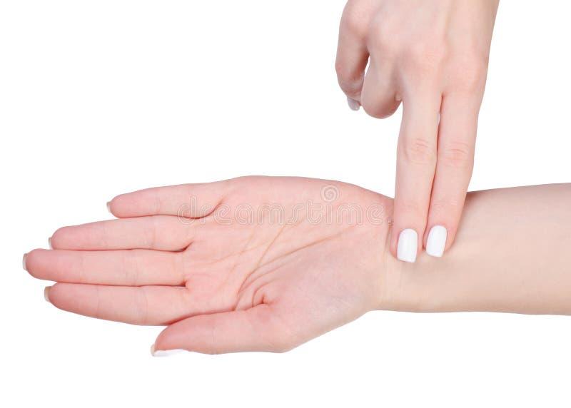 Vrouwelijke hand die impuls meten stock foto