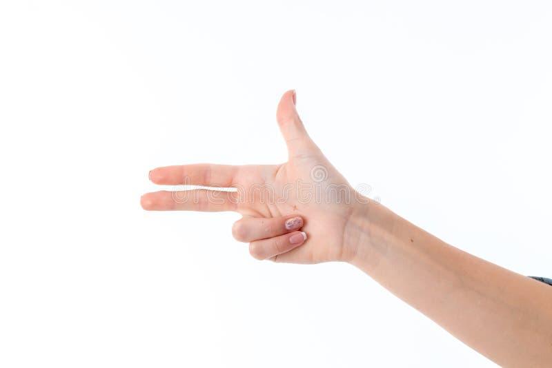 Vrouwelijke hand die met drie die vingersgebaar tonen op witte achtergrond wordt geïsoleerd royalty-vrije stock foto's