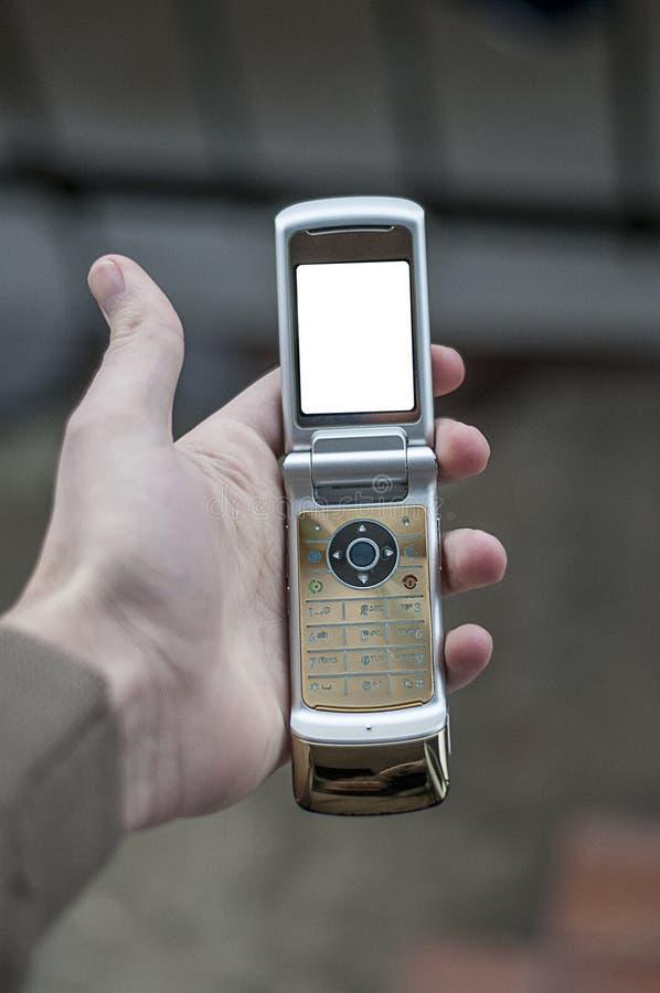 Vrouwelijke hand die moderne mobiele slimme telefoon houden royalty-vrije stock afbeelding