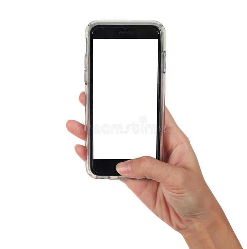 Vrouwelijke hand die verticale slimme telefoon, gebruik het knippen weg houden stock foto's