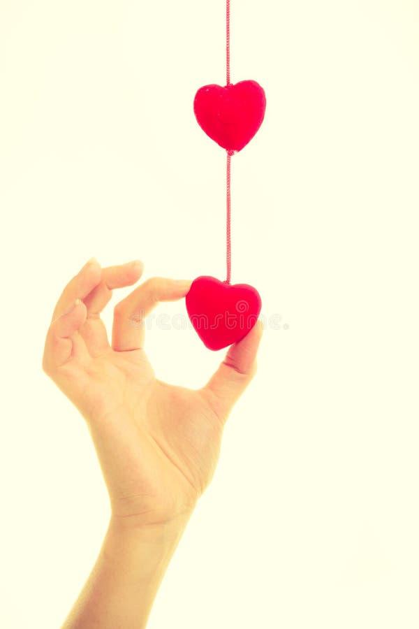 Vrouwelijke hand met kleine harten stock foto