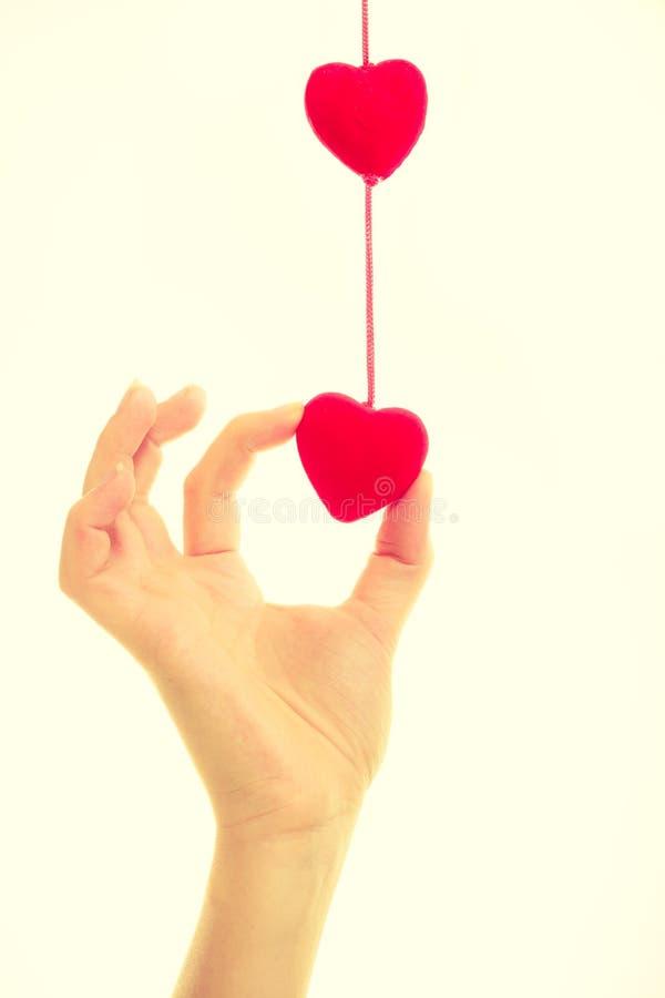 Vrouwelijke hand met kleine harten royalty-vrije stock afbeelding