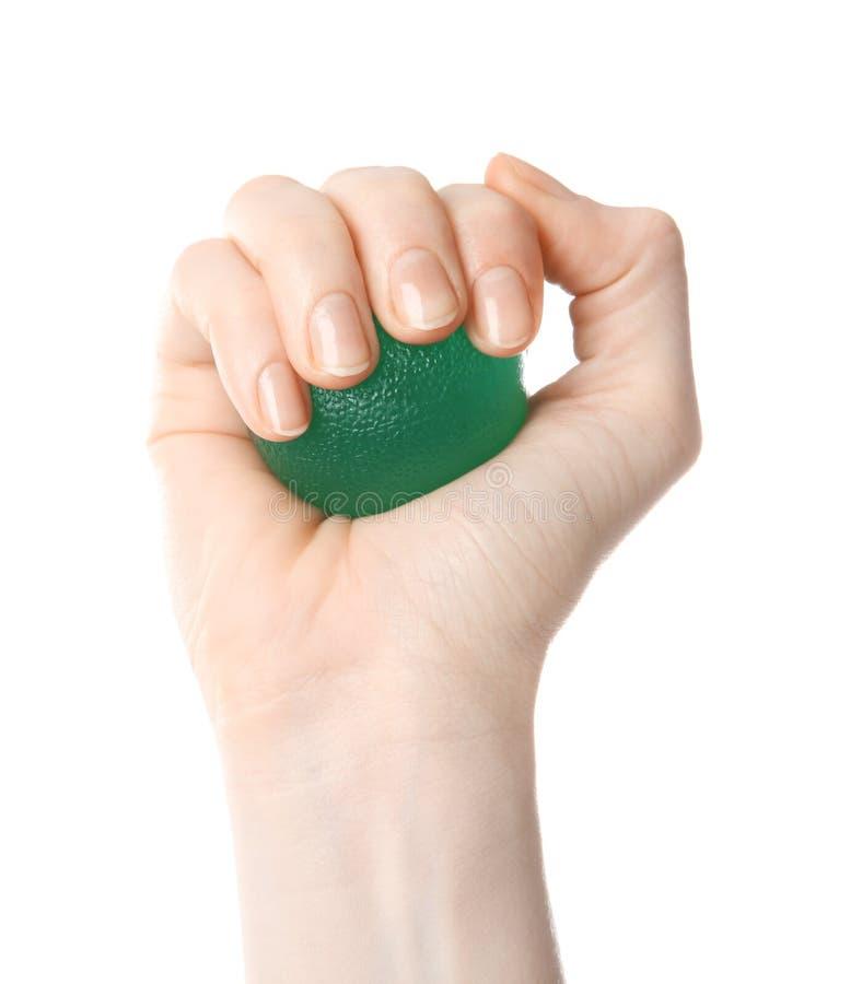 Vrouwelijke hand met spanningsbal stock afbeelding