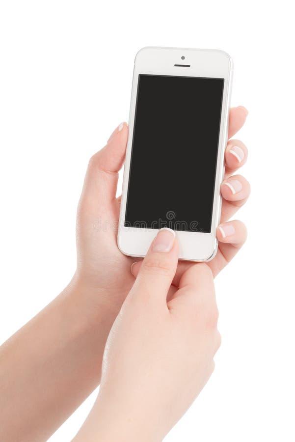 Vrouwelijke handen die witte moderne slimme telefoon houden en butto drukken royalty-vrije stock afbeeldingen