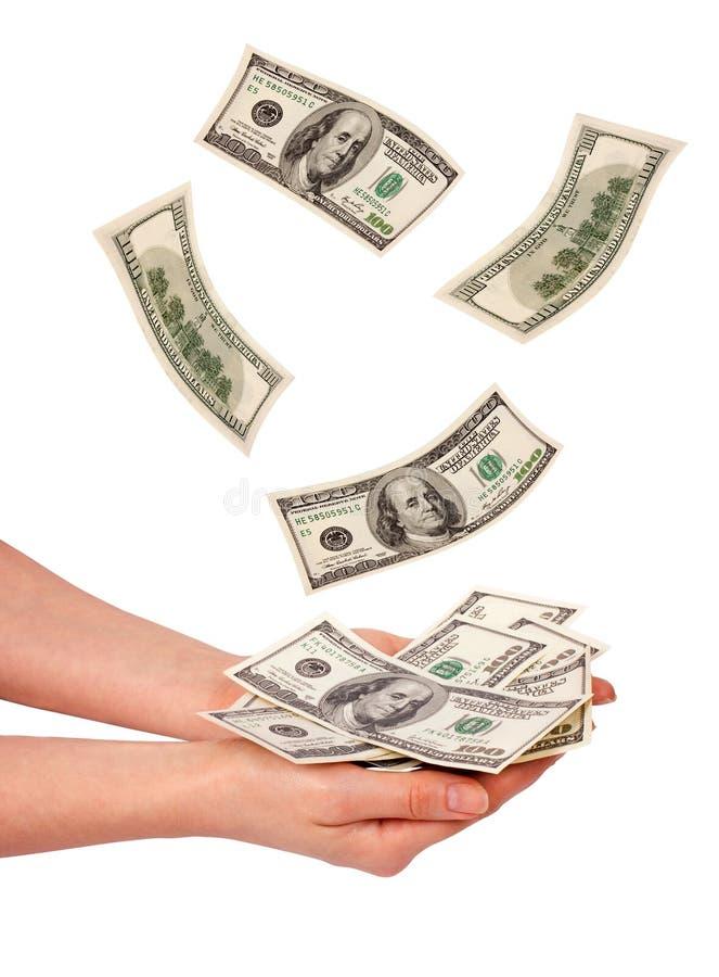 Vrouwelijke handen en dalend geld stock foto's