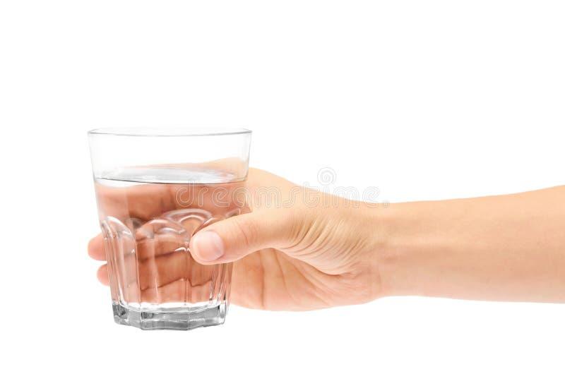 Vrouwelijke het glaskop van de handholding Geïsoleerdj op witte achtergrond royalty-vrije stock foto