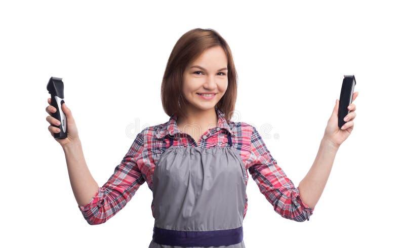 Vrouwelijke het haarmachines van de kapperholding bij witte achtergrond royalty-vrije stock foto's