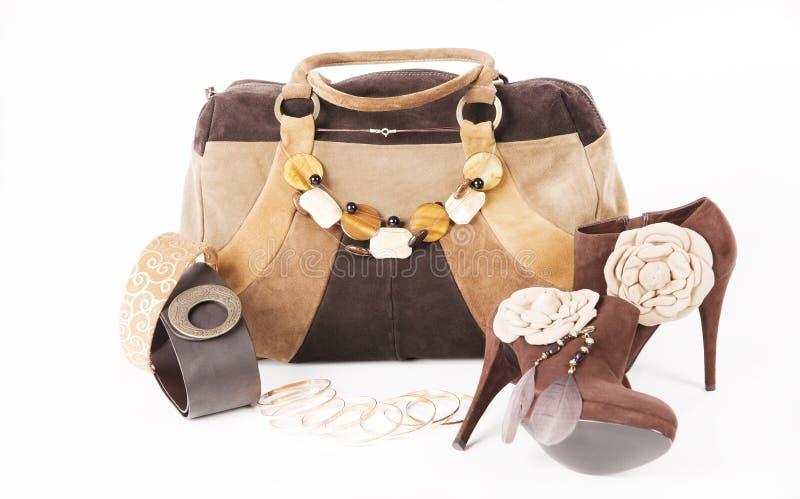 Vrouwelijke high-heeled laarzen en mooie zak stock foto