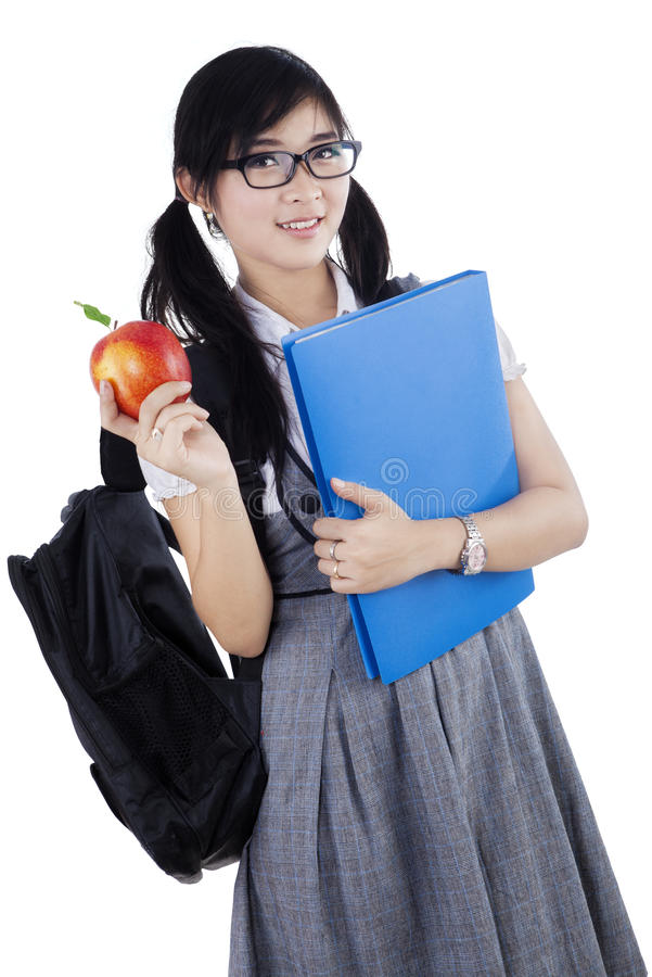 Vrouwelijke hoge geïsoleerde schoolstudent stock foto