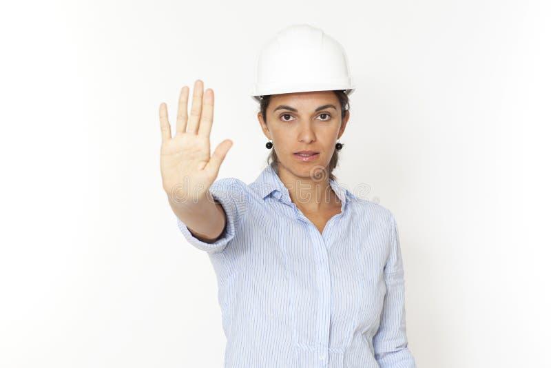 Vrouwelijke ingenieur die einde zegt stock afbeeldingen