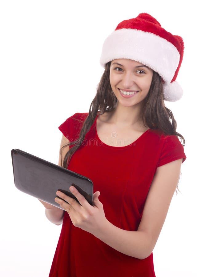 Vrouwelijke Kerstman gebruikend tablet stock afbeelding