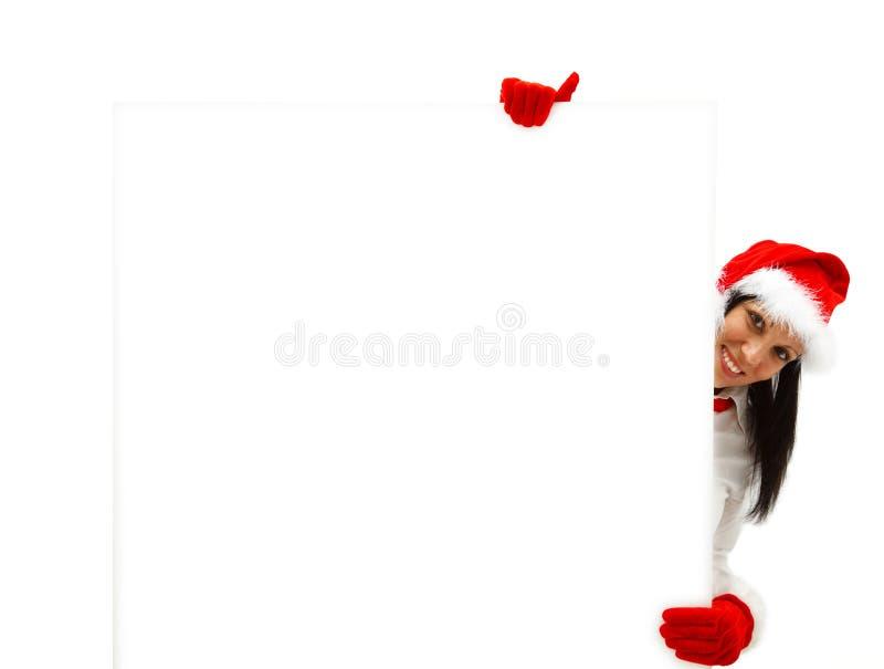Vrouwelijke Kerstman met aanplakbord stock afbeelding