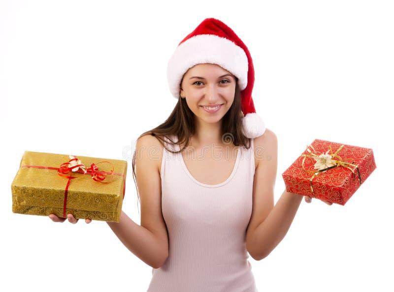 Vrouwelijke Kerstman met giftdozen. stock foto's