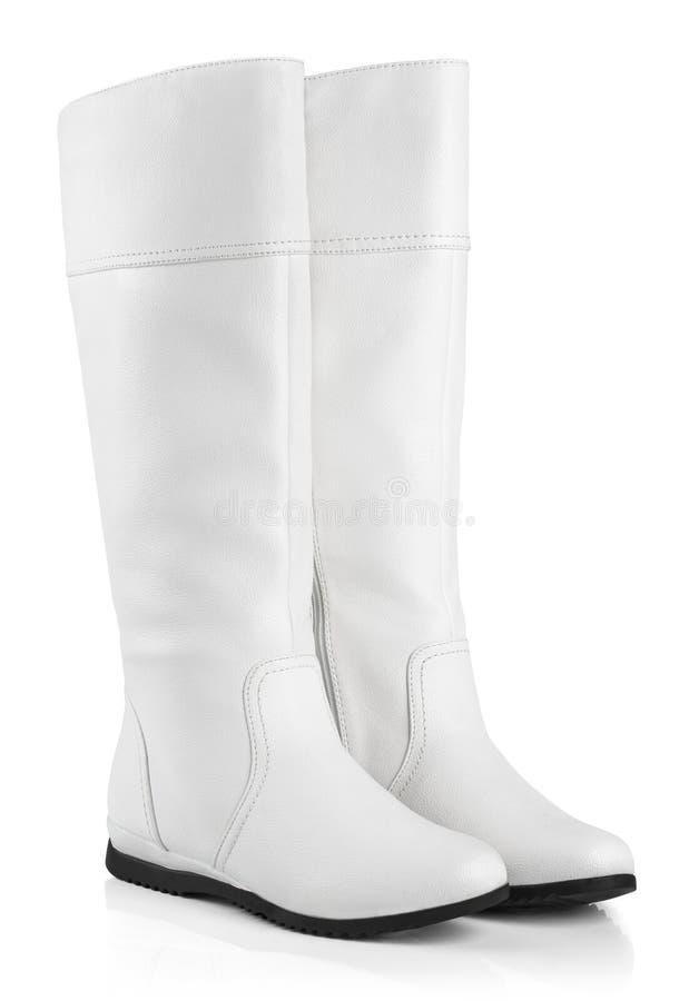 Vrouwelijke laarzen op wit stock afbeeldingen