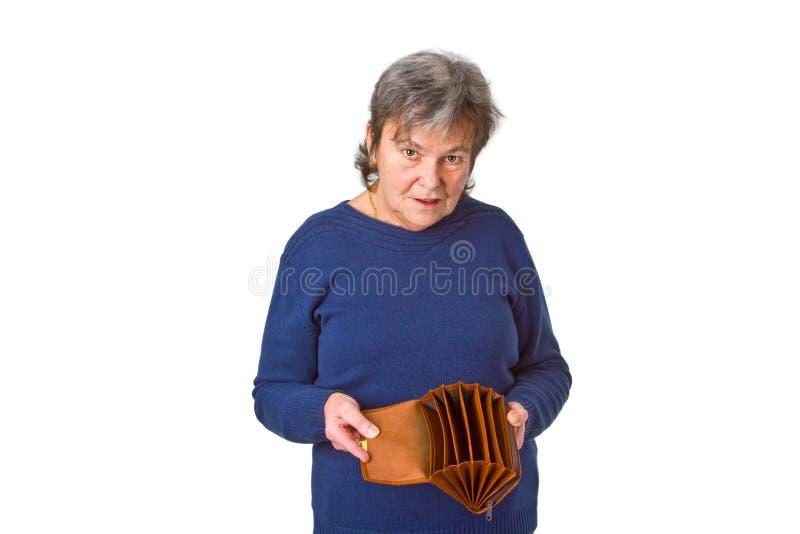 Vrouwelijke oudste die lege portefeuille toont royalty-vrije stock afbeeldingen