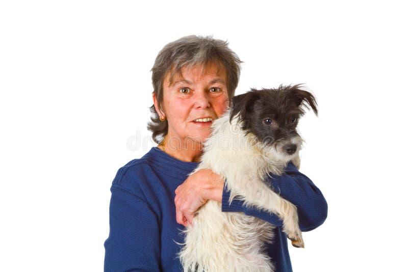 Vrouwelijke oudste met puppy royalty-vrije stock afbeeldingen