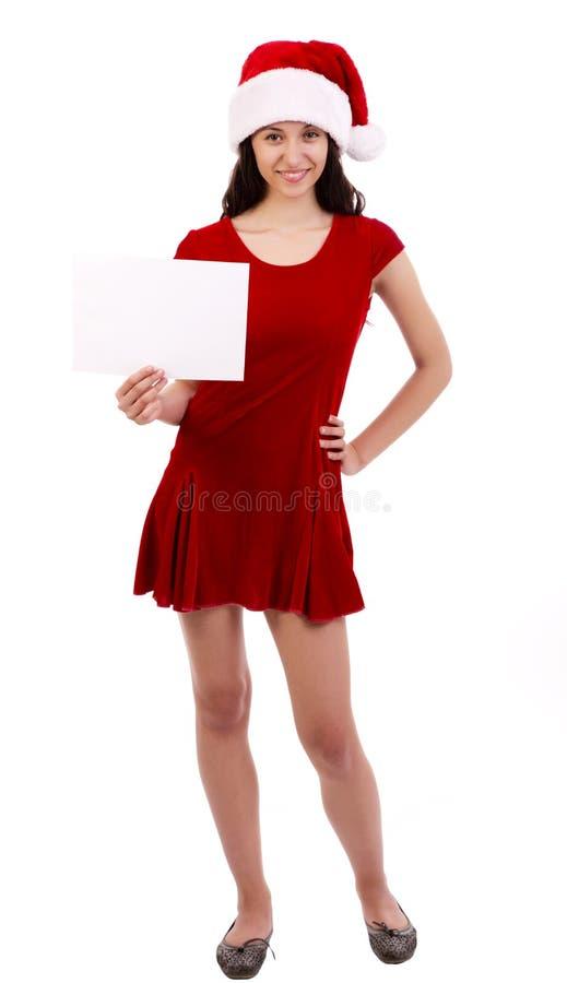 Vrouwelijke santa met aanplakbord stock fotografie