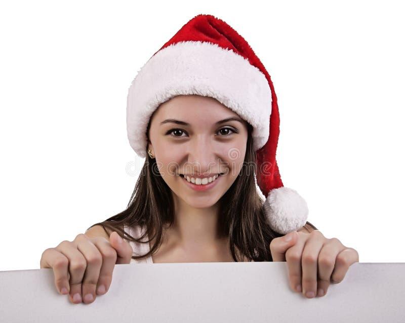 Vrouwelijke santa over een aanplakbord stock foto's