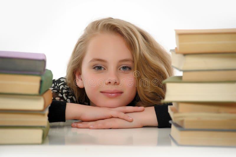 Vrouwelijke student met boeken stock foto's