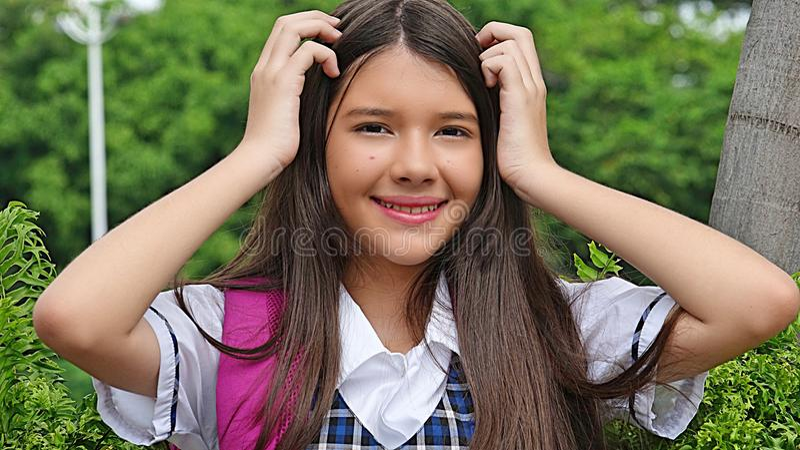Vrouwelijke Student Touching Hair stock foto