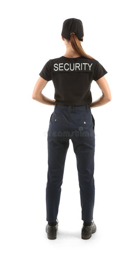 Vrouwelijke veiligheidsagent op witte achtergrond, achtermening stock afbeeldingen