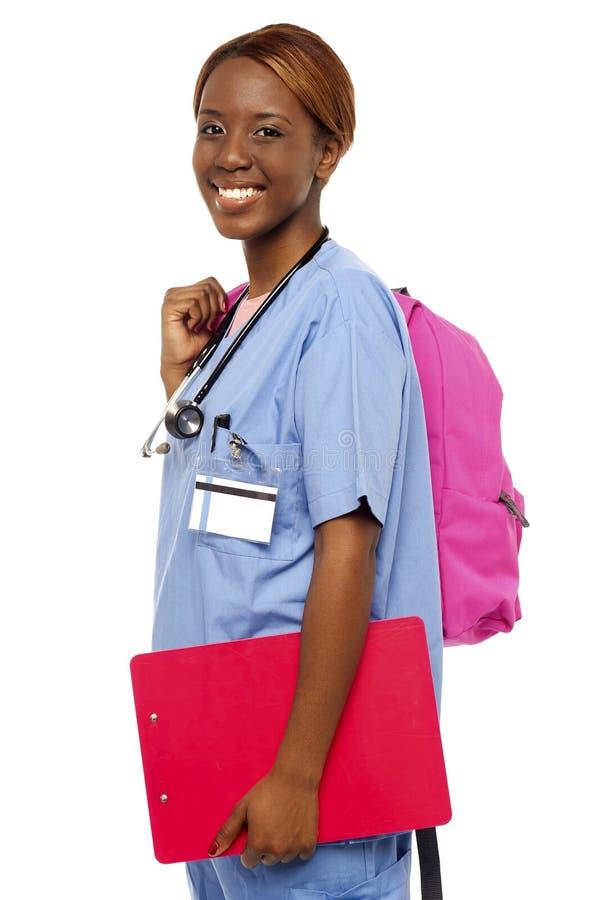 Vrouwelijke verpleegster onder opleiding stock afbeeldingen