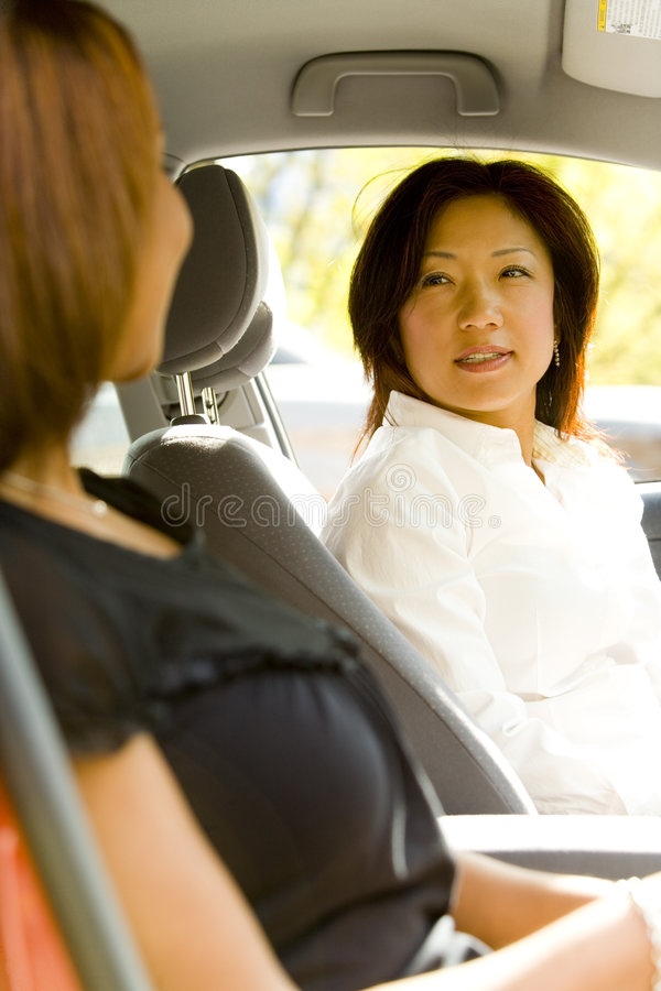 Vrouwen in Auto stock afbeelding