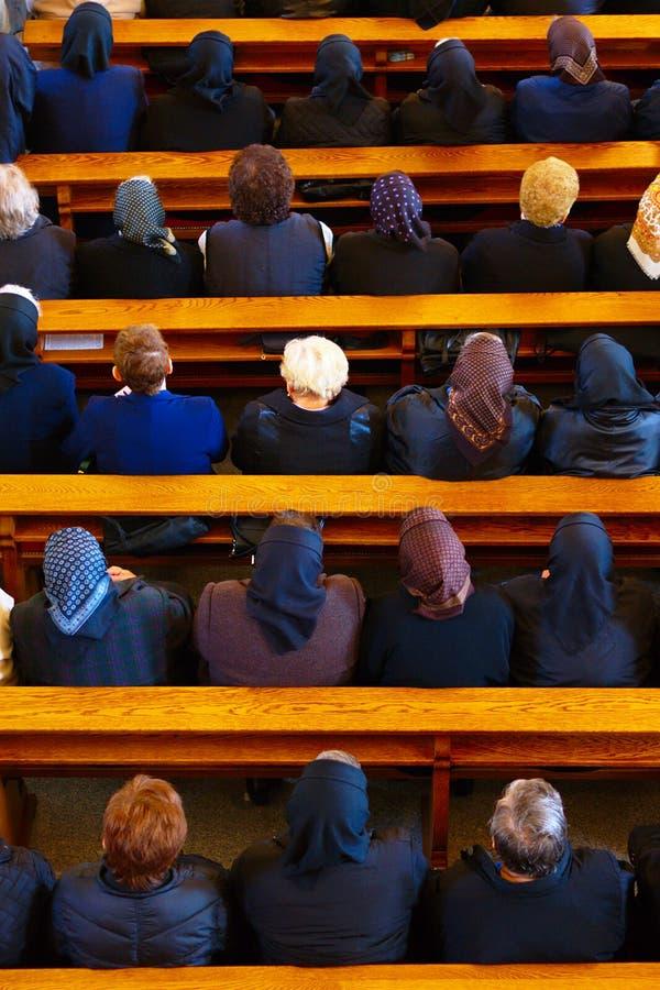 Vrouwen in de Kerk stock foto's