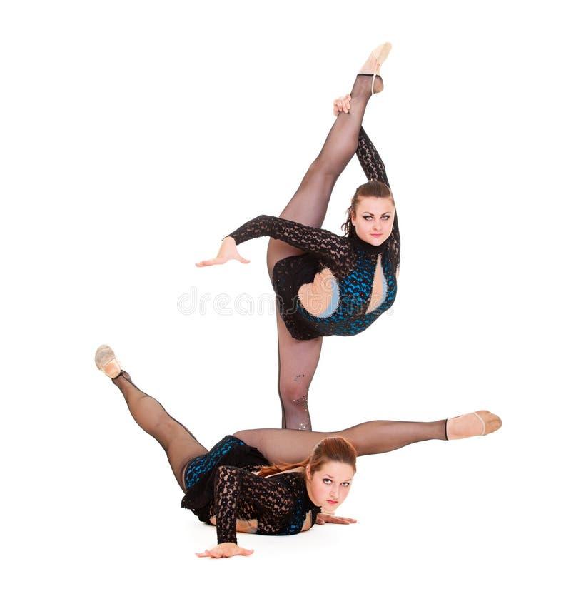 Vrouwen die ritmische gymnastiek tonen royalty-vrije stock afbeelding