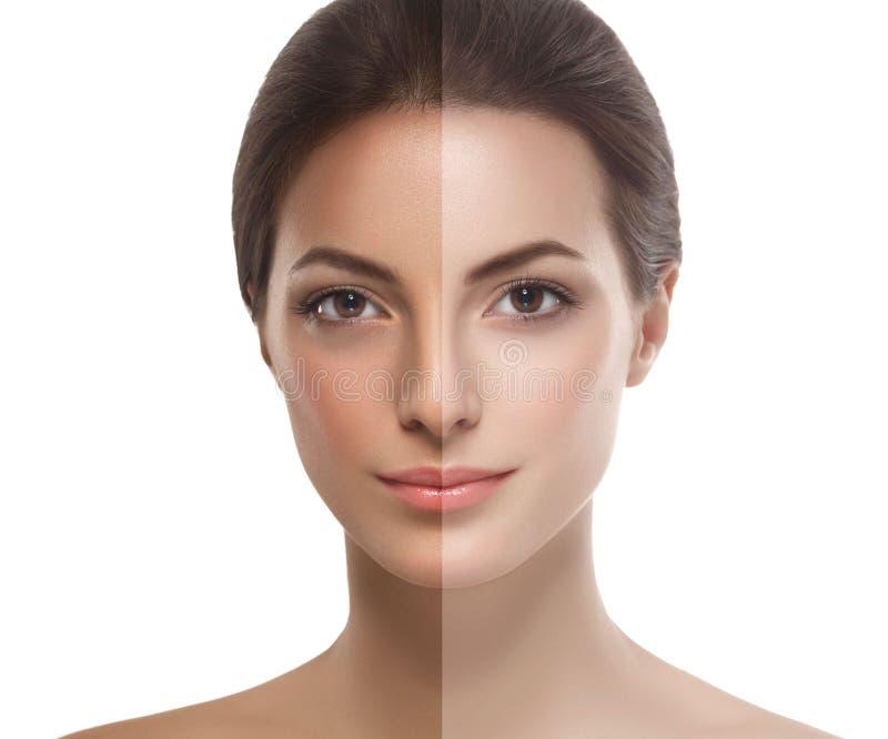 Vrouwen helft-gezicht tan de gelukkige jonge mooie gezonde halve huid van het studioportret stock foto's