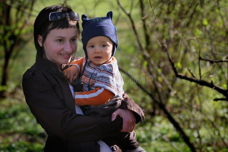 Vrouwen met haar baby stock foto's