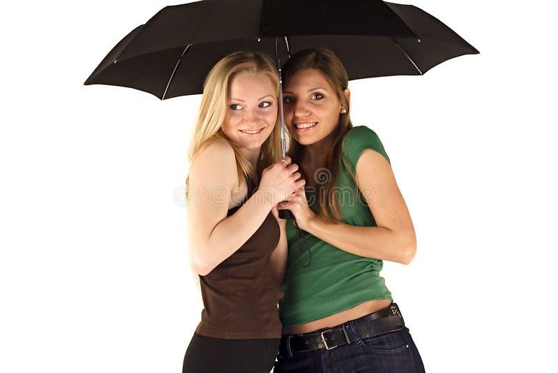 Vrouwen onder paraplu stock foto