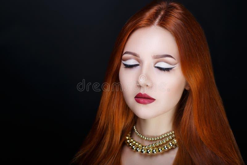 Vrouwen oranje haar stock foto