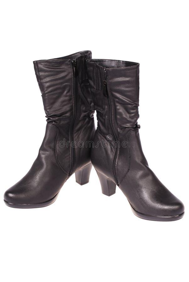 Vrouwen` s laarzen die weg knippen stock afbeelding