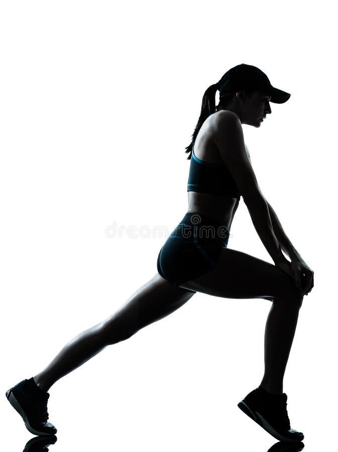 Vrouwenagent jogger het uitrekken zich opwarmingssilhouet royalty-vrije stock fotografie