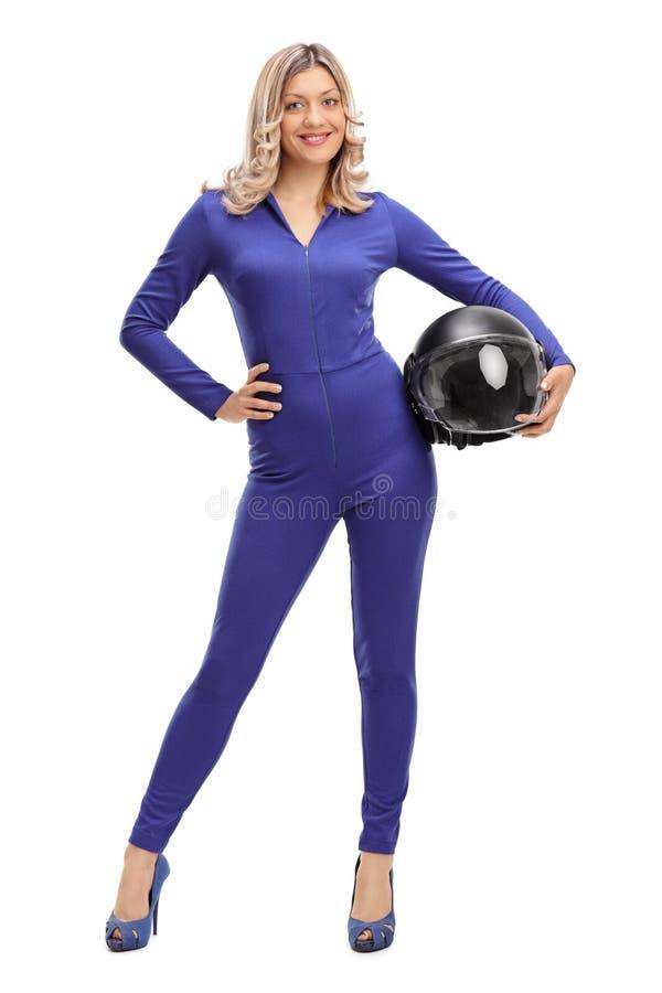 Vrouwenautoracer in een blauw het rennen kostuum royalty-vrije stock afbeeldingen