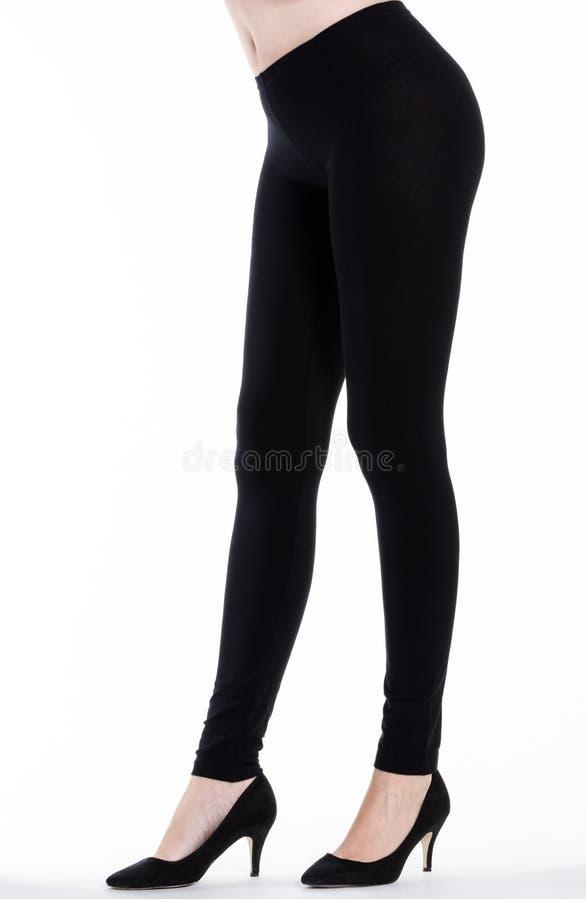 Vrouwenbenen met beenkappen stock afbeelding