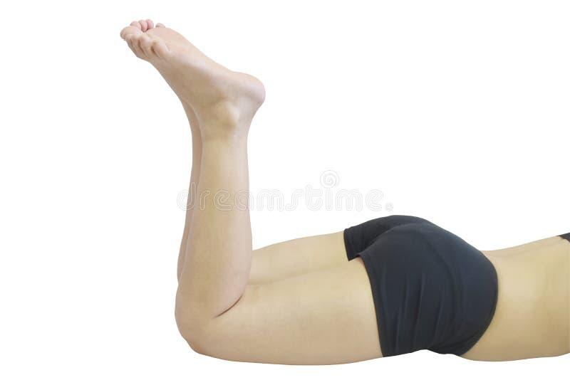 Vrouwenbenen op witte achtergrond worden geïsoleerd die stock afbeelding