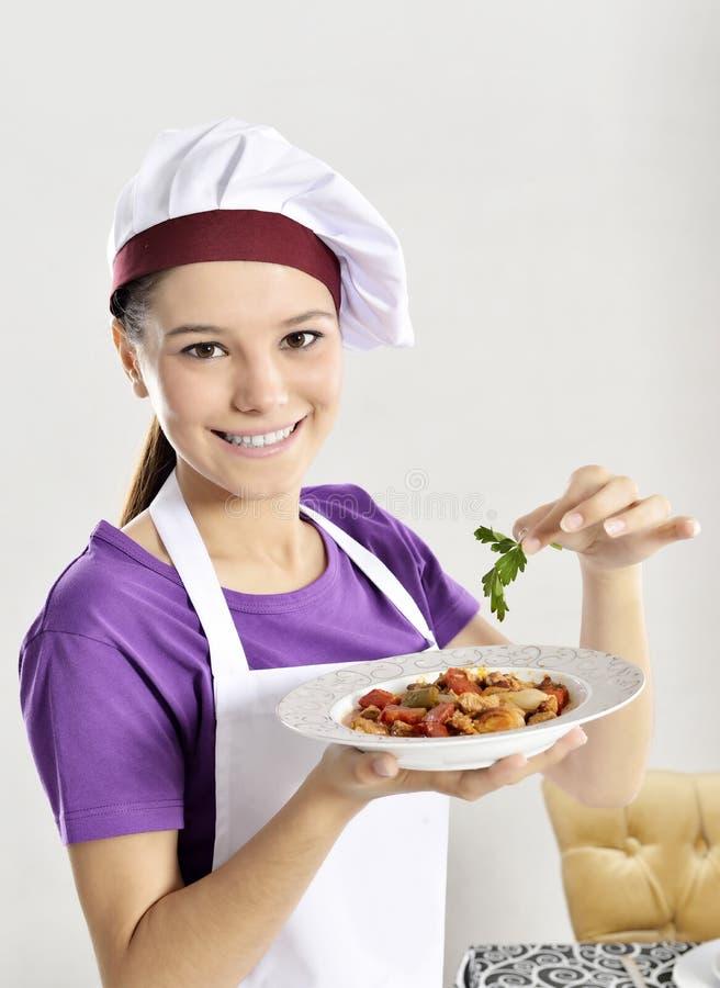 Vrouwenchef-kok stock afbeelding