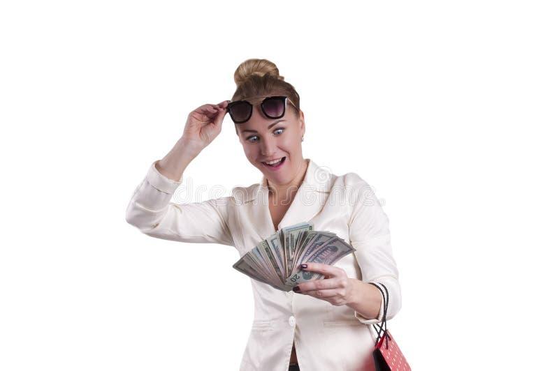 Vrouwendollars het winkelen zakken, geïsoleerde verrassing stock foto