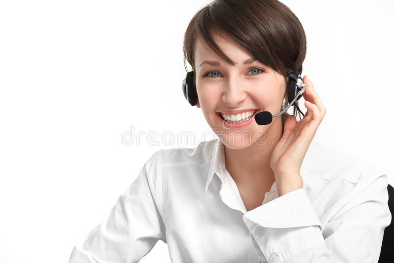 Vrouwenexploitant met hoofdtelefoon - microfoon en hoofdtelefoons stock foto