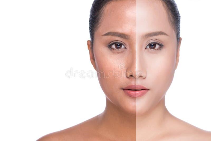 Vrouwengezicht met halve die tan huid op witte achtergrond wordt geïsoleerd stock foto's