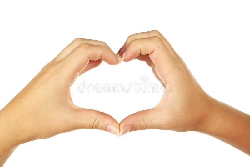 Vrouwenhand die een hart maken stock afbeelding